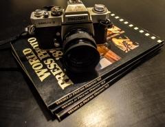 3 Worldpress Photo boeken €0,50 p.s. en een Ricoh Singlet analoge camera €5,00